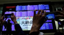 Asia stocks dip on likely smaller Fed rate cut, oil gains