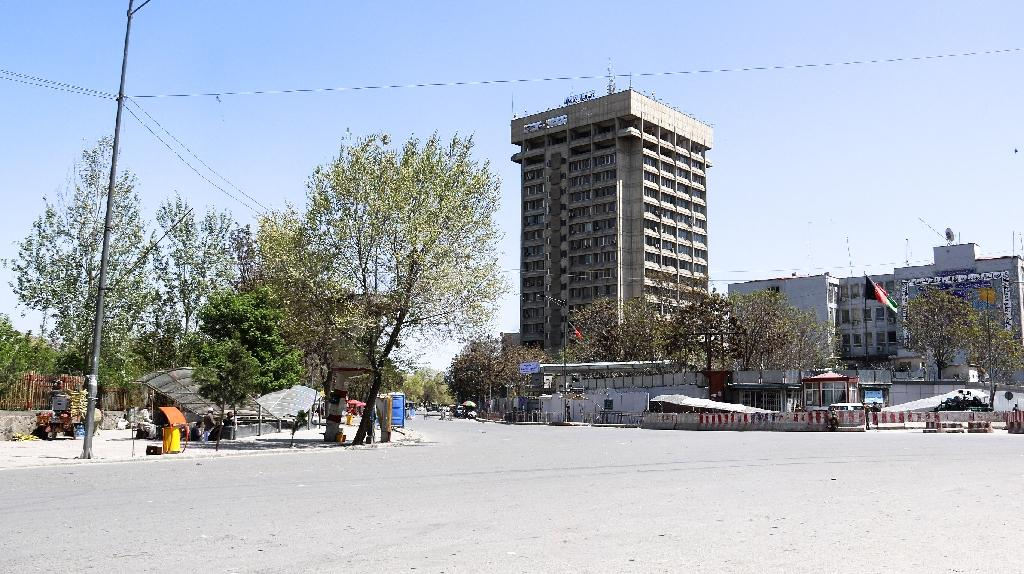 Panicked workers inside the 18-storey building, believed to be Kabul's tallest, moved up to the top floor as gunmen and Afghan security officials battled lower down (AFP Photo/STR)