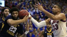 Kansas storms back from down 14 to tighten its grip on Big 12 race