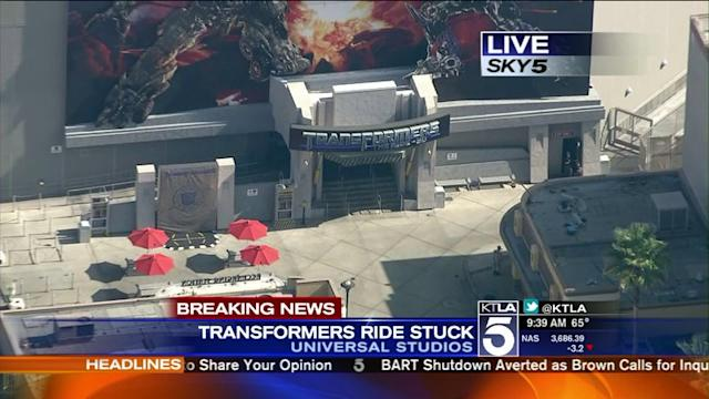 Visitors Stuck on Transformers Ride