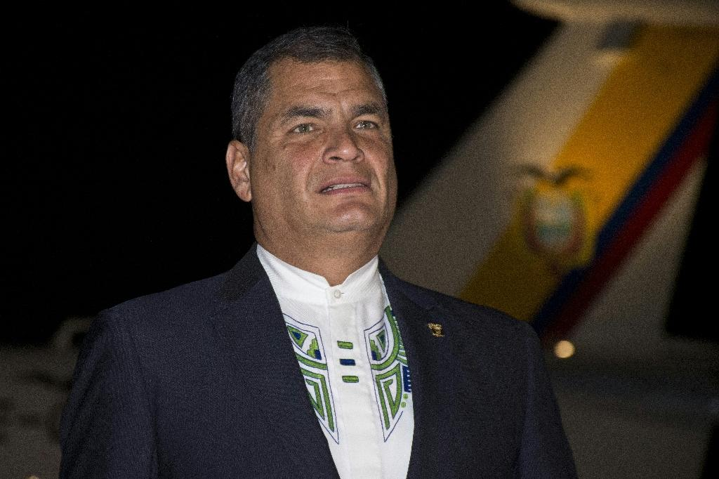 Ecuador's President Rafael Correa, gesturing uppon arrival at Rafael Nunez airport to attend the XXV Ibero-American Summit in Cartagena, Colombia, on October 28, 2016