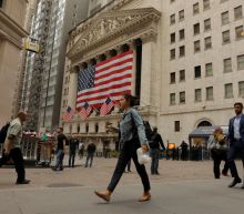 Dow, S&P touch record highs on relief from trade concerns