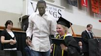 Randy Moss hands diploma to cancer survivor
