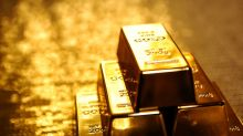 Gold ends higher amid decline in U.S. equities, defying dollar's rise