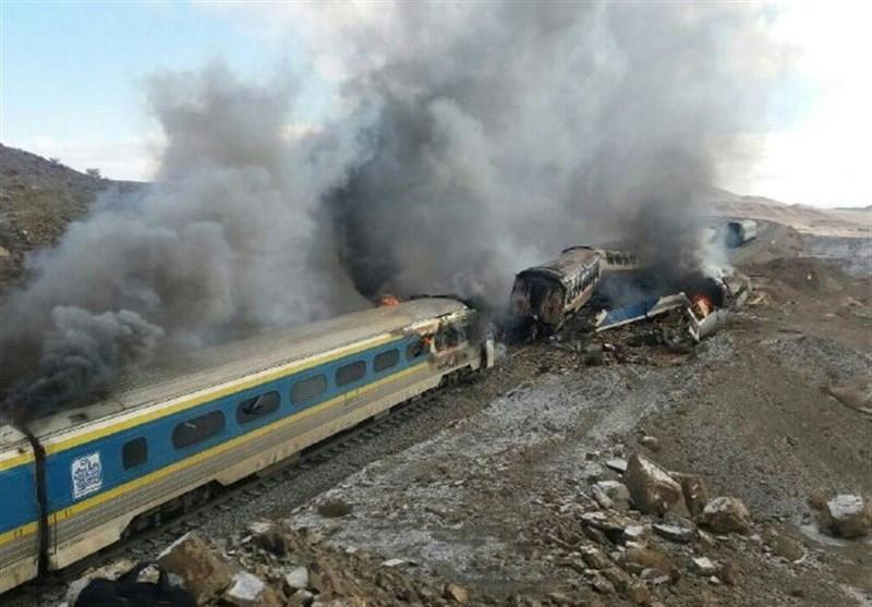 Smoke billows from destroyed train carriages following an accident in Semnan province, some 250 kms east of the Iranian capital Tehran, on November 25, 2016 (AFP Photo/)