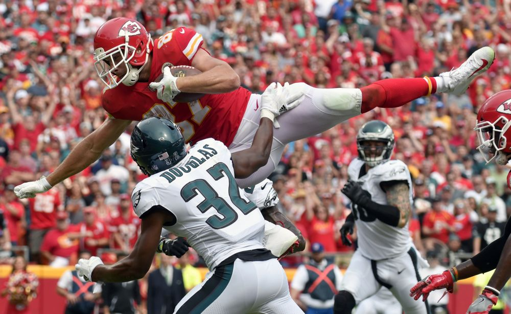 Chiefs tight end Travis Kelce leaps over Eagles cornerback Rasul Douglas for a touchdown on Sunday. (AP)