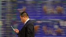Stocks sink as bond yields, dollar regain traction
