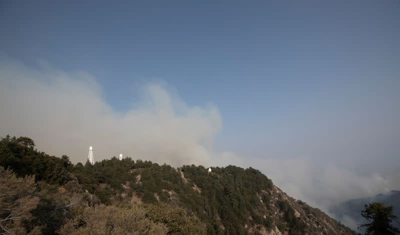 Smoke rises near Mount Wilson Observatory during the Bobcat Fire in Los Angeles