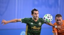 Portland reaches knockout stage after 2-1 win over Houston