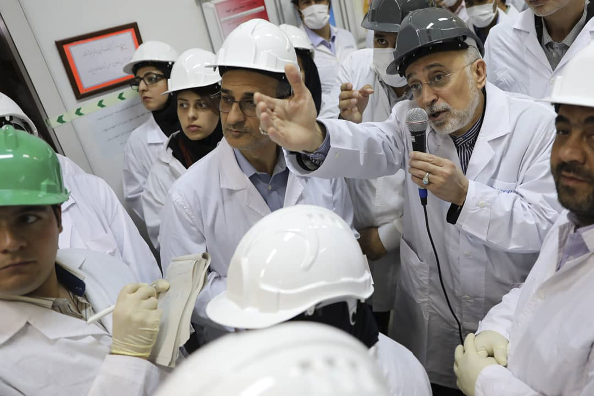 """FILE - In this file photo released Nov. 4, 2019 by the Atomic Energy Organization of Iran, Ali Akbar Salehi, head of the organization, speaks with media while visiting Natanz enrichment facility, in central Iran. The landmark 2015 deal between Tehran and world powers meant to prevent Iran from obtaining nuclear weapons has been teetering on the edge of collapse since the U.S. pulled unilaterally in 2018. The EU said Wednesday, Jan. 8, 2020, that it will """"spare no effort"""" to keep the deal alive, but with tensions between the U.S. escalating into open hostilities it's seeming increasingly unlikely that will be possible. (Atomic Energy Organization of Iran via AP, File)"""