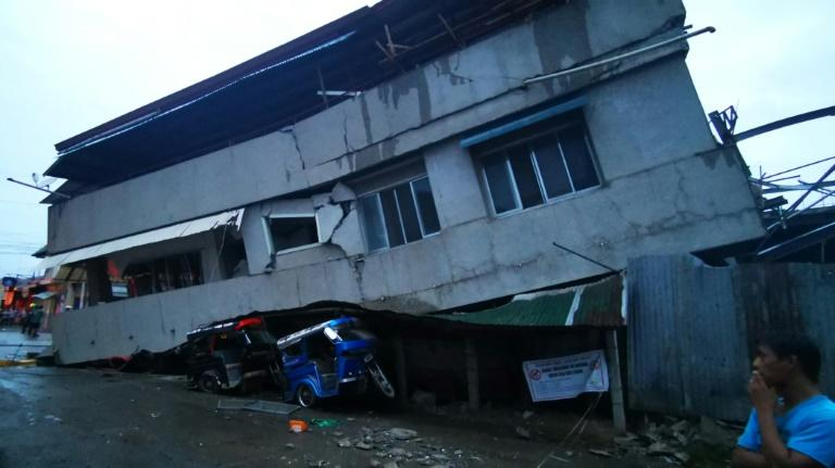 Sunday's tremor cracked schools, toppled homes and injured dozens but largely spared big cities on the island of Mindanao (AFP Photo/FERDINANDH CABRERA)
