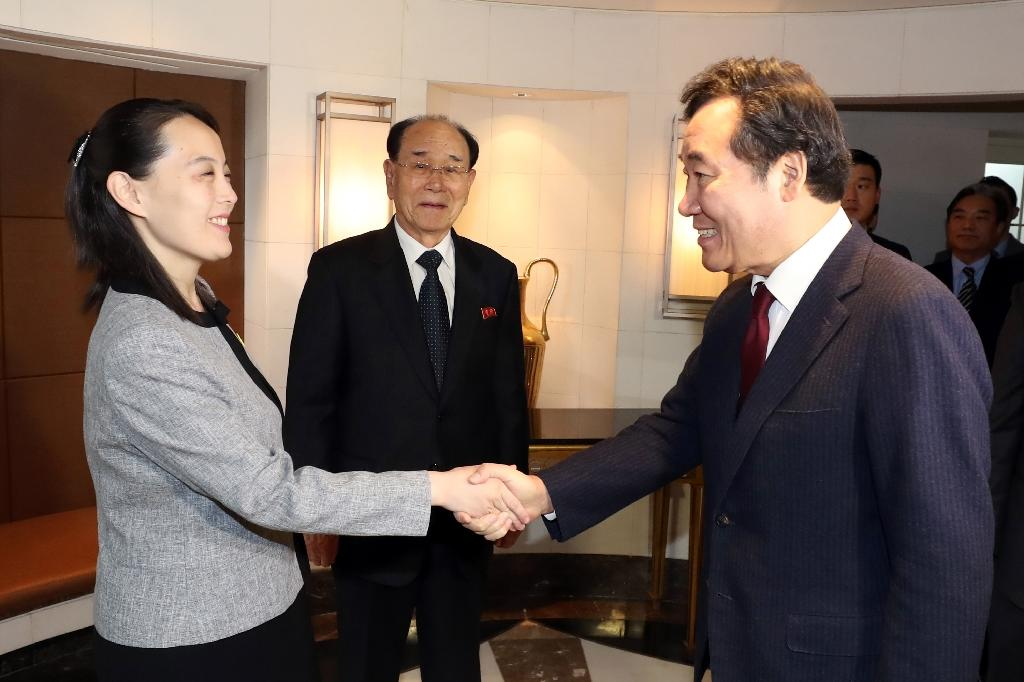 South Korea's Prime Minister Lee Nak-yon (R) shakes hands with North Korean leader Kim Jong Un's sister Kim Yo Jong (L) as North Korea's ceremonial head of state Kim Yong Nam (C) looks on during their meeting at a hotel in Seoul (AFP Photo/-)