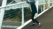 Watch: Teen filmed throwing a shopping trolley from footbridge onto busy duel carriageway