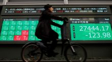 Asian markets step back from record highs made on Biden's stimulus proposal
