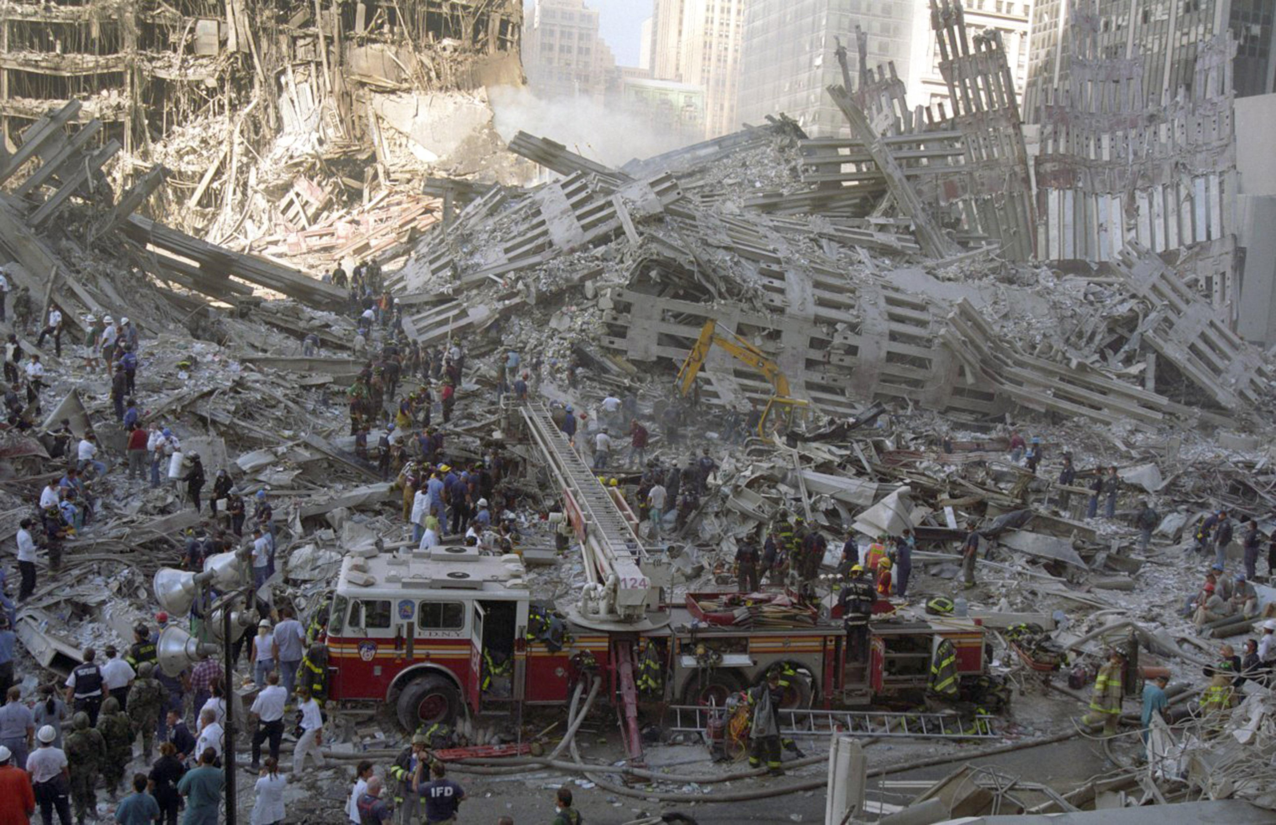 A fire engine is brought in to sift through the wreckage of one of the towers. (Caters)