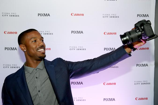 AUSTIN, TX - OCTOBER 01:  Actor Michael B. Jordan takes a selfie with a Canon at the Canon PIXMA PRO City Senses Galary at Austin Music Hall in Austin on October 1, 2014.  (Photo by Tasos Katopodis/Getty Images for Canon)
