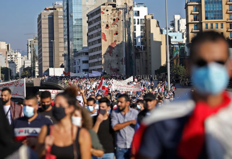 People march during a demonstration in Beirut
