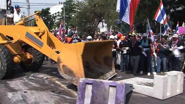 Thai protest tensions ease as barricades come down