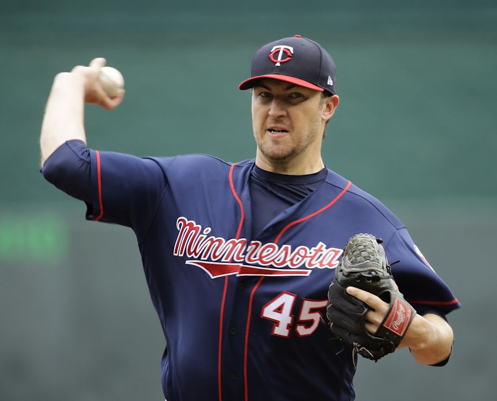 Phil Hughes is back in the Twins rotation after surgery last year. (AP)