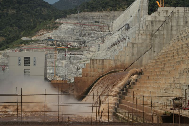 FILE PHOTO: Water flows through Ethiopia's Grand Renaissance Dam as it undergoes construction work on the river Nile in Guba Woreda
