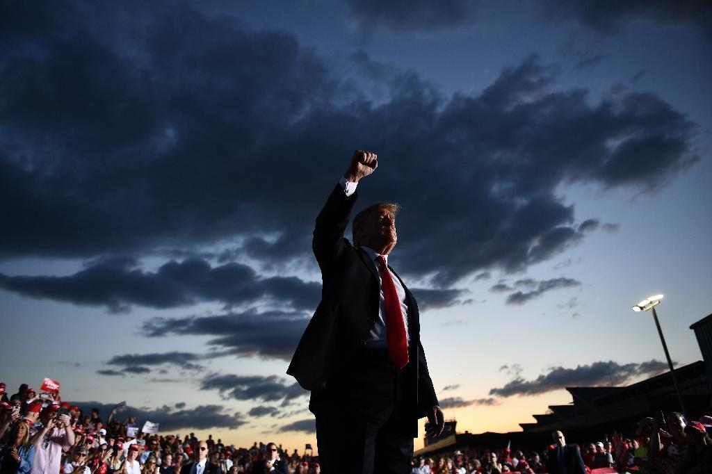 Is it lights out or a new dawn for US President Donald Trump, who faces poor poll numbers but can still find a way to victory in his 2020 reelection battle (AFP Photo/Brendan Smialowski)