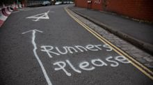 Fed-up residents spray paint 'runners lane' into road to keep social-distancing joggers away