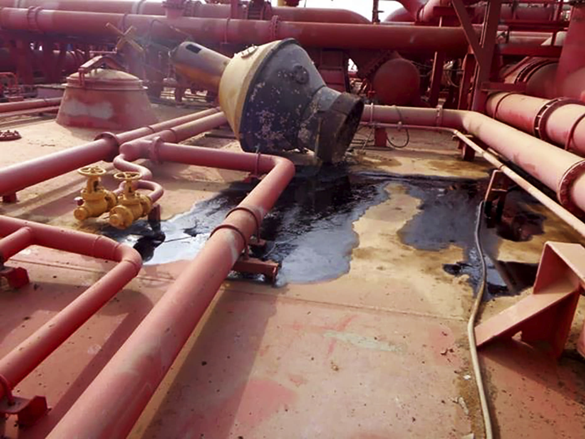 This image provided by I.R. Consilium taken in 2019, shows the deck of the FSO Safer, indicating the lack of basic maintenance for several years, leading to incidental smaller spills, moored off Ras Issa port, Yemen. Houthi rebels are blocking the United Nations from inspecting the abandoned oil tanker loaded with more than one million barrels of crude oil. UN officials and experts fear the tanker could explode or leak, causing massive environmental damage to Red Sea marine life. (I.R. Consilium via AP)