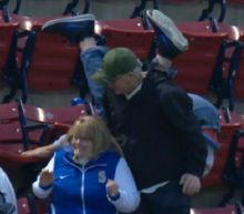 Fan takes scary tumble after missing foul ball at Fenway Park