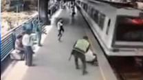 Cop saves suicidal man from train in Colombia