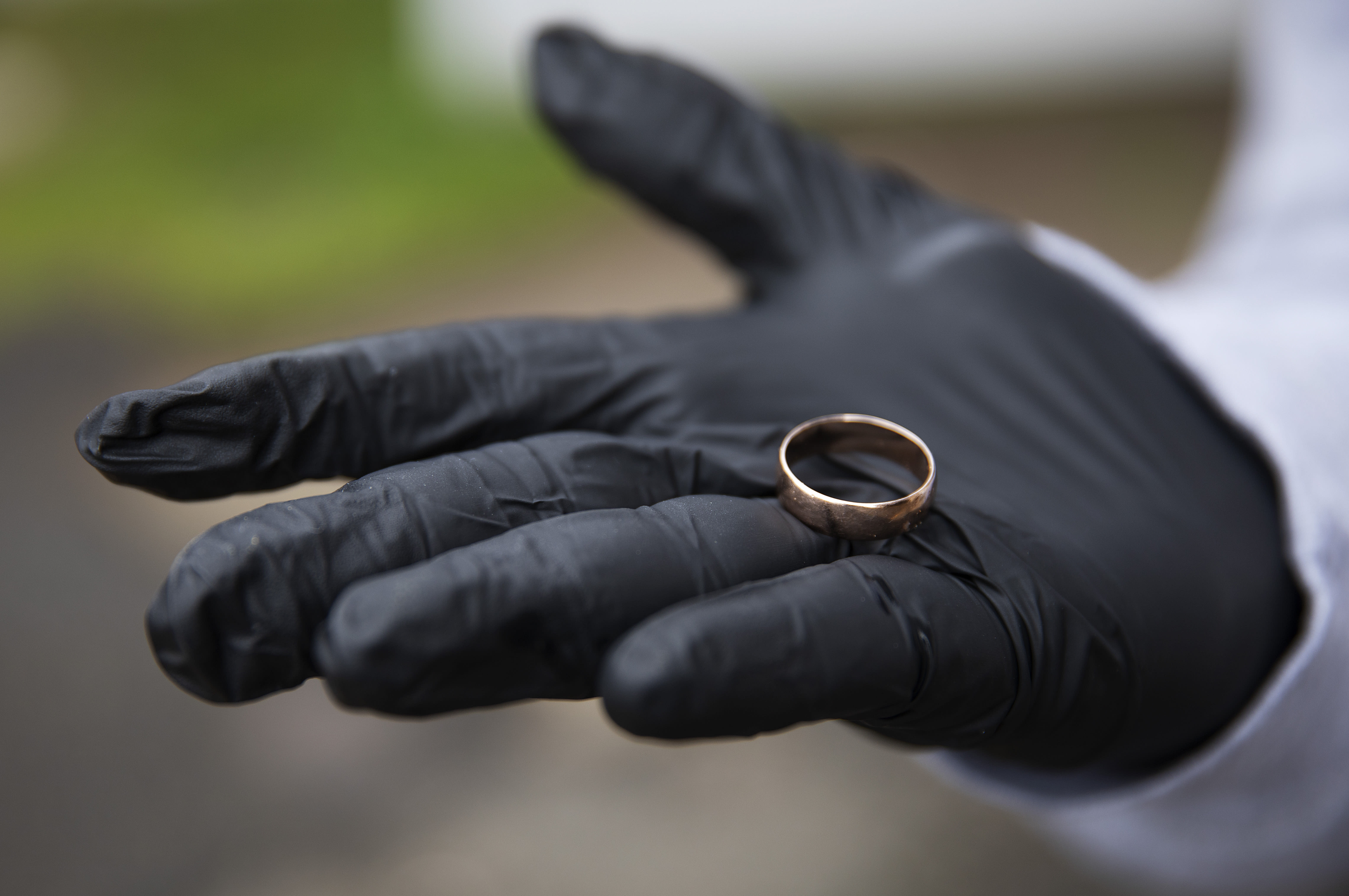 """Michael Tokar holds the ring of his father, David Tokar, after it was returned to him before his burial at Mount Richmond Cemetery in the Staten Island borough of New York, Wednesday April 8, 2020. """"My father wore this ring all his life and I want to keep it for me. It's the best memory. It's like part of my father."""" (AP Photo/David Goldman)"""