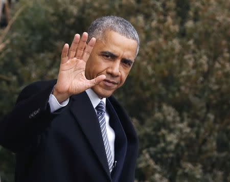 U.S. President Barack Obama waves as he walks towards Marine One on the South Lawn of the White House in Washington