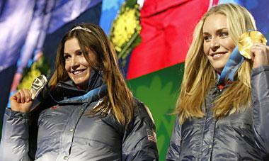 Julia Mancuso, left, wears her tiara, while showing off her silver medal while teammate Lindsey Vonn displays her gold