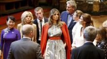 The First Lady Dons a 'Cape' to Mingle With World Leaders
