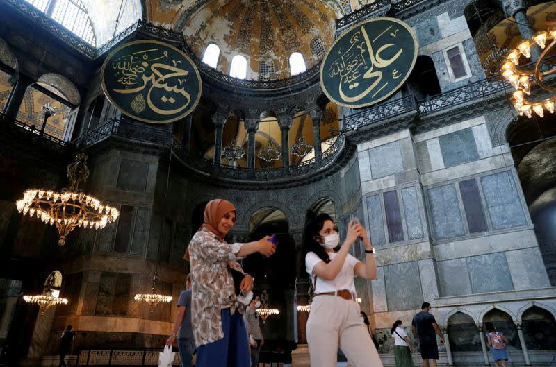 FILE PHOTO: People pose for a selfie as they visit the Hagia Sophia or Ayasofya in Istanbul