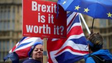Britain agrees Brexit divorce deal with EU, May's opponents vow to thwart it