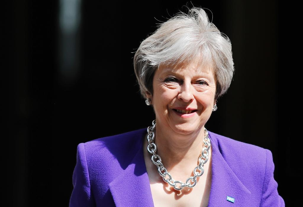 May is due to address parliament later on Monday to explain her plan for Britain to adopt EU rules on goods after Brexit (AFP Photo/Tolga AKMEN)