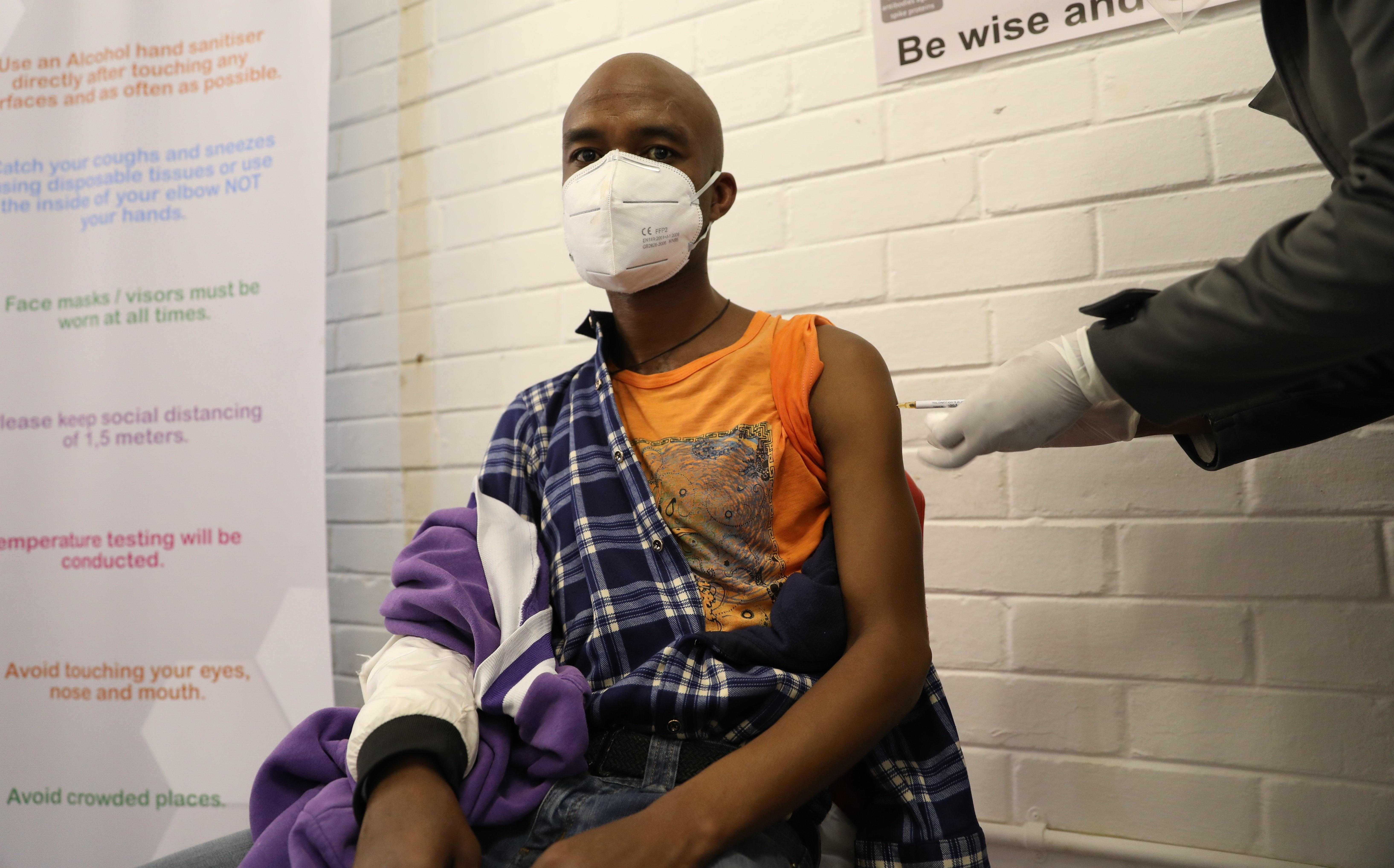 Promising vaccine trial pushes into COVID-swamped South Africa, Brazil