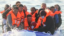 Migrants seen on 'dangerously packed' dinghy heading for Britain