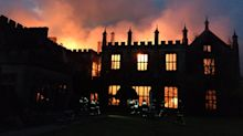 Millionaire banker questioned over fire that gutted his 500-year-old Grade-1 mansion