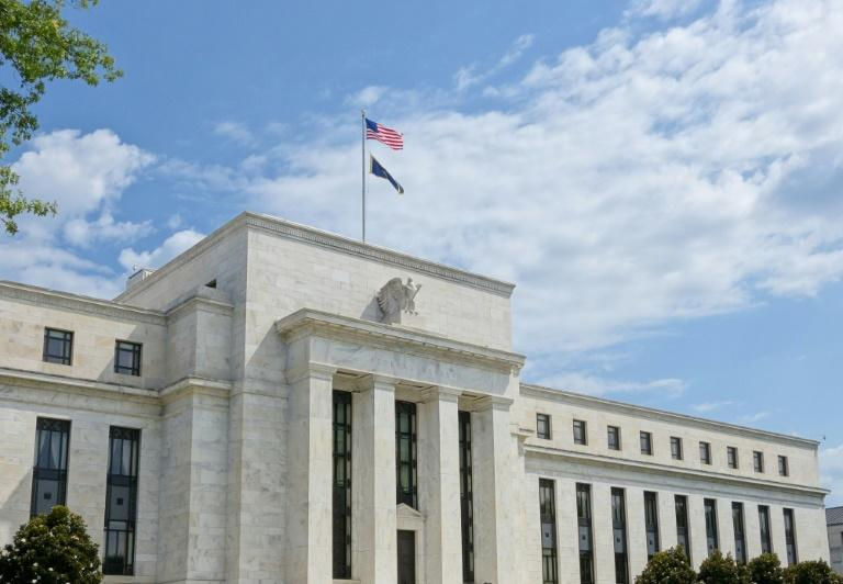 The US Federal Reserve has signaled it will only shift interest rates if there is a 'material' change to the economic outlook (AFP Photo/KAREN BLEIER)