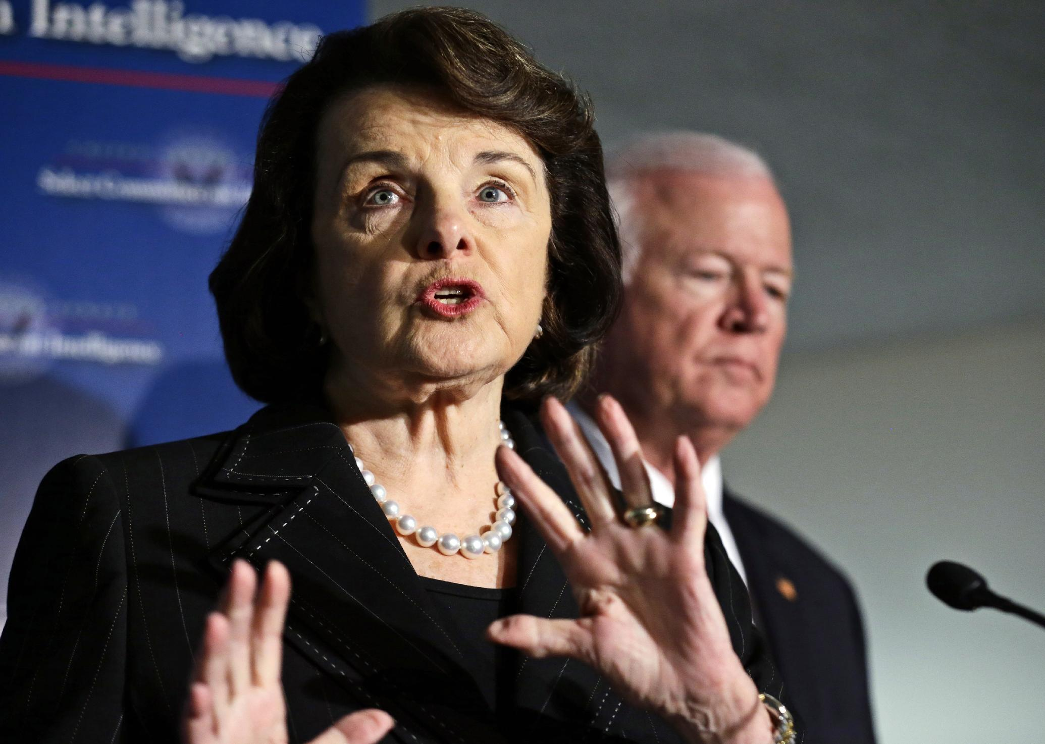 Senate Intelligence Committee Chair Sen. Dianne Feinstein, D-Calif., left, with Senate Intelligence Committee Vice Chairman Sen. Saxby Chambliss, R-Ga., right, speaks during a media availability after a closed-door oversight hearing of the committee on Capitol Hill in Washington, Thursday, Nov. 15, 2012, looking into the circumstances surrounding the deadly attack on the U.S. Consulate in Benghazi, Libya. (AP Photo/Alex Brandon)