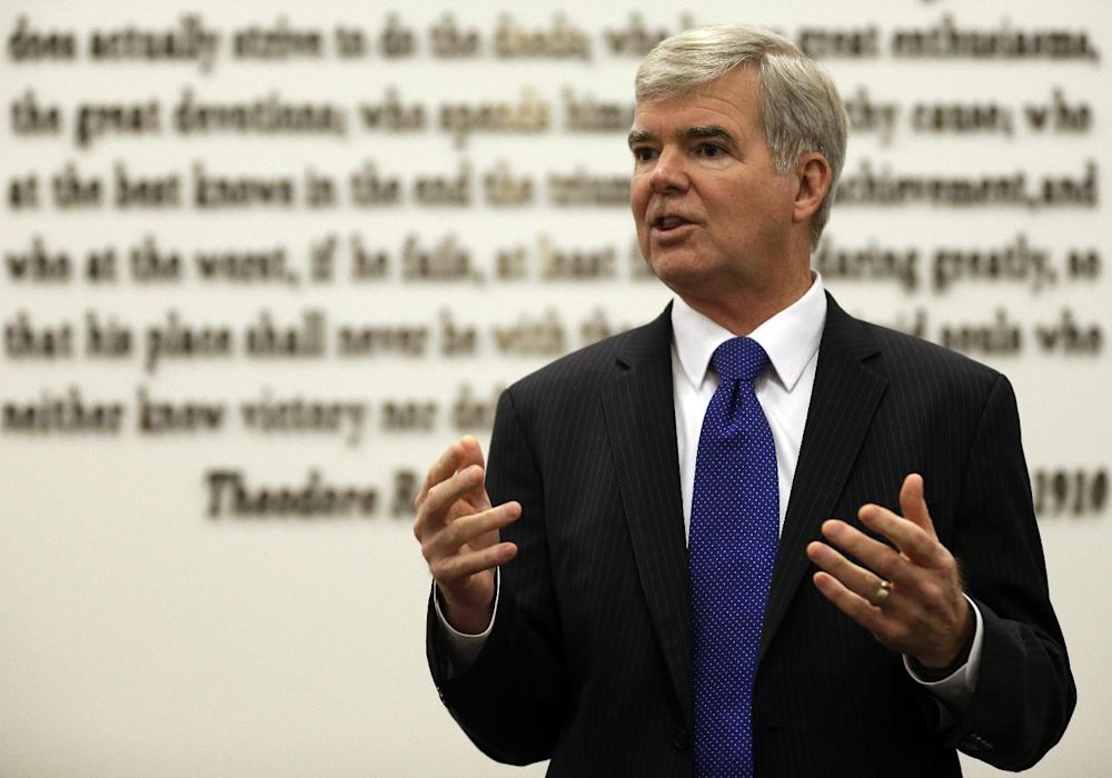 NCAA President Mark Emmert gestures while speaking at NCAA headquarters in Indianapolis, Thursday, Aug. 7, 2014. The NCAA Board of Directors overwhelmingly approved a package of historic reforms Thursday that will give the nation's five biggest conferences the ability to unilaterally change some of the basic rules governing college sports