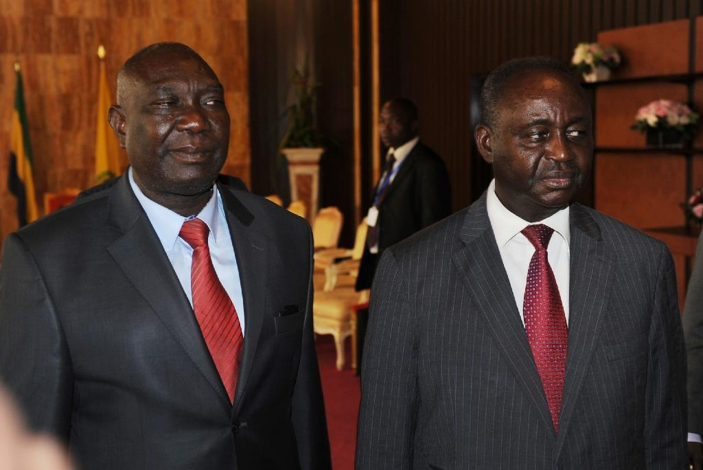 """Central African Republic ex-presidents Francois Bozize (R) and Michel Djotodia (L), seen here in 2013, have backed a 2014 deal on the """"cessation of hostilities"""", sources say"""