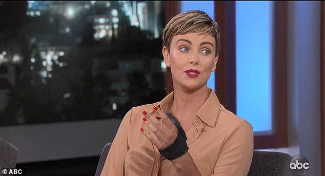 Charlize Theron didn't realise she'd torn a ligament in her hand for two months