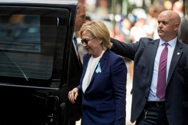 Hillary Clinton gets into a van as she leaves an apartment building Sunday, Sept. 11, 2016, in New York. (Andrew Harnik/AP)