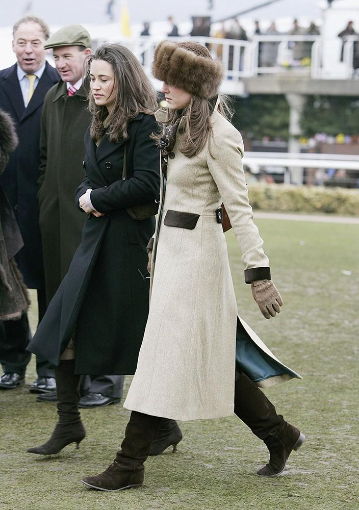 Kate wore flat boots, a long coat and Russian-style fur hat at the Cheltenham Festival with her sister Pippa.