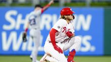 Phillies rally with 7 runs in 8th inning to beat Marlins 8-3