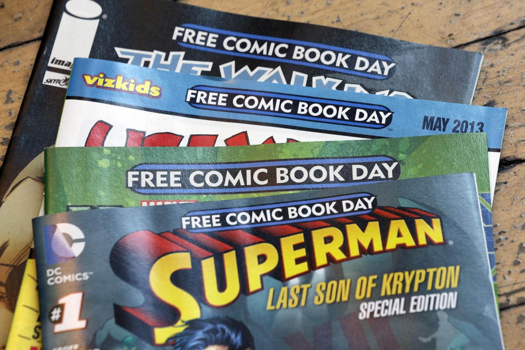 Displayed are comics set asside for Free Comic Book Day at Brave New Worlds, Wednesday, May 1, 2013, in Philadelphia. When the doors open Saturday, May 4 for Free Comic Book Day the annual event that's grown from a few scattered stores hundreds upon hundreds worldwide publishers and purveyors of tales of fantastic heroes and nefarious villains will be eager to court new readers who, in spite of easy access to digital comics, are making time and spending money on comics printed on paper and increasing the demand for new books and titles. (AP Photo/Matt Rourke)