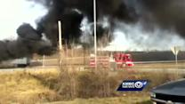 Tractor-trailer bursts into flames on Highway 210
