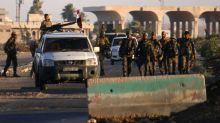 Syria reopens two border crossings, but many escape regime control